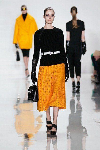 Clothing, Sleeve, Human body, Shoulder, Joint, Outerwear, Style, Waist, Street fashion, Orange,