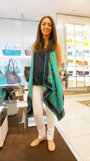Outerwear, Street fashion, Turquoise, Teal, Bag, Knee, Long hair, Foot, Fashion design, Fashion model,