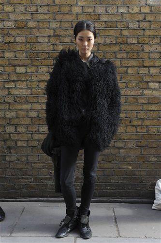 Textile, Outerwear, Style, Street fashion, Brick, Fashion, Knee, Fur clothing, Natural material, Fashion model,