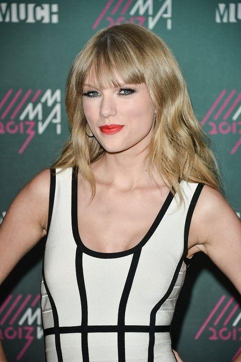 Lip, Hairstyle, Sleeveless shirt, Bangs, Eyelash, Style, Logo, Blond, Brown hair, Long hair,