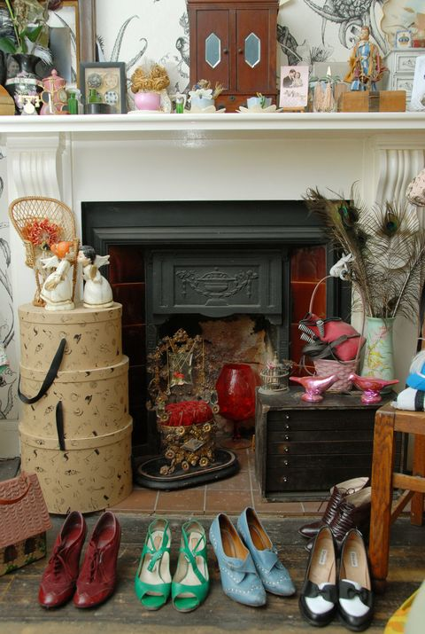 Footwear, Shoe, Interior design, Interior design, Tan, Home, Picture frame, Collection, Fireplace, Hearth,