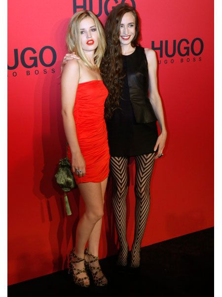 Dress, Red, Human leg, Style, Cocktail dress, One-piece garment, Flooring, Fashion, Thigh, High heels,