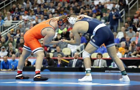 Sports uniform, Blue, Sportswear, Human leg, Shoe, Scholastic wrestling, Elbow, Textile, Photograph, Sport venue,