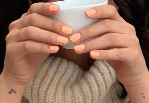 Finger, Skin, Hand, Nail, Thumb, Wrist, Drinkware, Cup, Wool, Gesture,