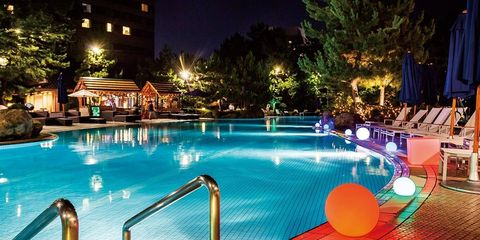 Swimming pool, Leisure, Resort, Lighting, Resort town, Vacation, Night, Hotel, Building, Fun,