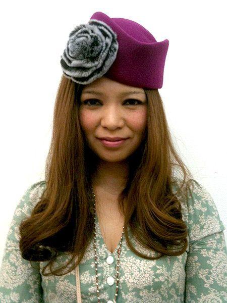 Clothing, Lip, Chin, Textile, Style, Beret, Headgear, Costume accessory, Long hair, Fashion,