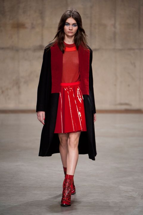 Clothing, Sleeve, Joint, Outerwear, Fashion show, Red, Style, Fashion model, Street fashion, Runway,