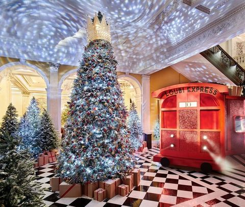 Blue, Lighting, Interior design, Christmas decoration, Ceiling, Christmas tree, Interior design, Floor, Woody plant, Holiday,