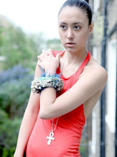 Clothing, Finger, Shoulder, Dress, Eyelash, Style, Wrist, Fashion accessory, Beauty, Fashion,