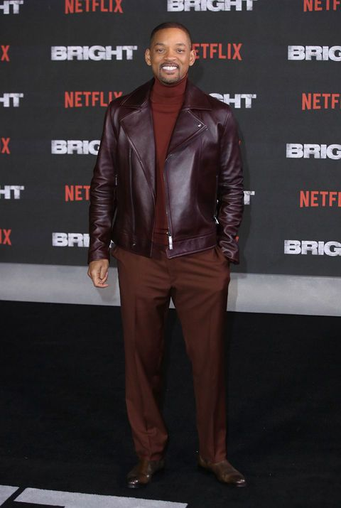 Leather, Clothing, Leather jacket, Jacket, Textile, Carpet, Premiere, Suit, Event, Outerwear,