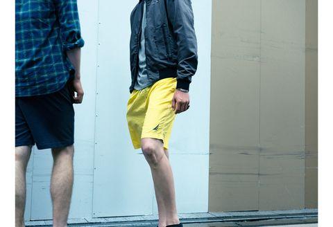 Clothing, Yellow, Shorts, Street fashion, Fashion, Denim, Footwear, Standing, Bermuda shorts, Leg,