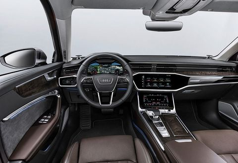 Land vehicle, Vehicle, Car, Center console, Steering wheel, Automotive design, Motor vehicle, Personal luxury car, Luxury vehicle, Gear shift,