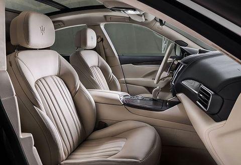 Land vehicle, Vehicle, Car, Luxury vehicle, Personal luxury car, Car seat cover, Car seat, Automotive design, Center console, Gear shift,