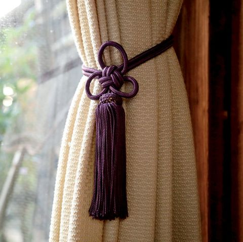 Curtain, Window treatment, Interior design, Textile, Purple, Outerwear, Wool, Fashion accessory, Rope, Knot,