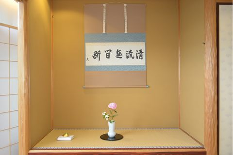Yellow, Room, Interior design, Fixture, Toy, Tile, Figurine, Vase, Artificial flower, Varnish,