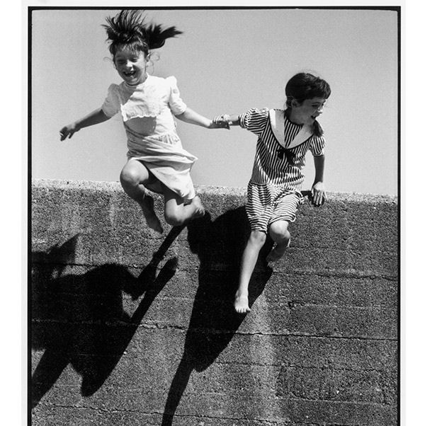 Photograph, Jumping, Photography, Monochrome, Snapshot, Black-and-white, Monochrome photography, Gesture, Stock photography, Vintage clothing,