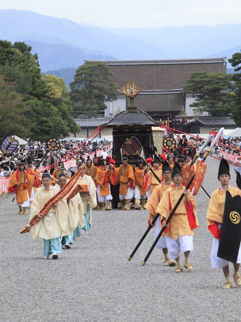 Tree, Tradition, Pole, Costume, Parade, Festival, Temple, Musical ensemble, Shrine, Wind instrument,