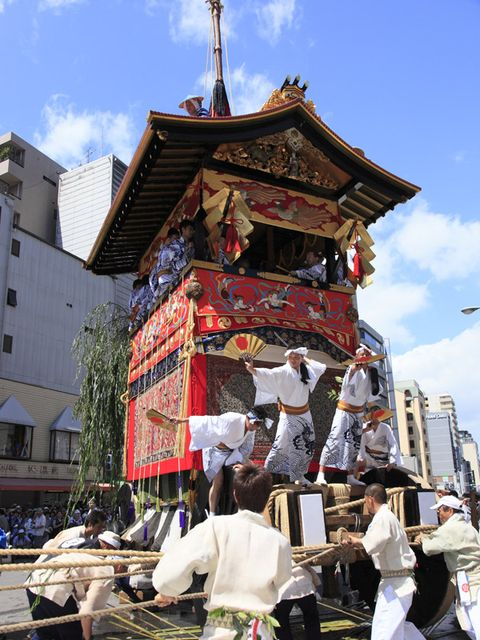 Tradition, Temple, Place of worship, Temple, Performance art, Pole, Street light, Ritual, Dance, Chinese architecture,