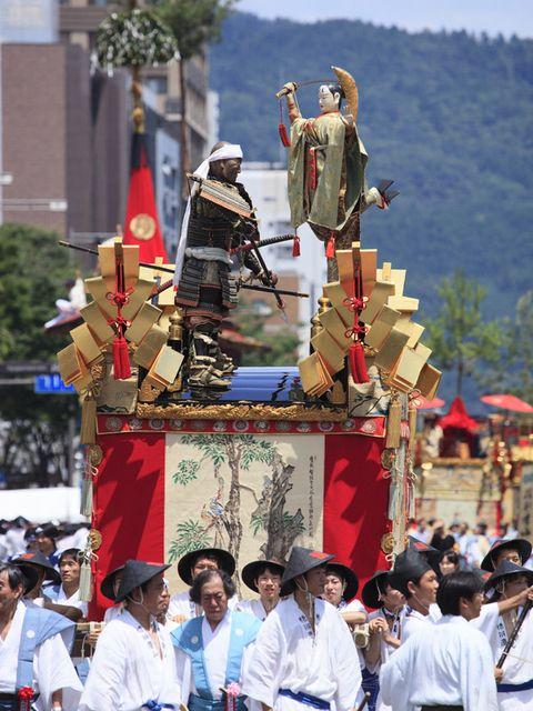 People, Mammal, Tradition, Headgear, Crowd, Temple, Ritual, Pilgrimage, Festival, Sculpture,