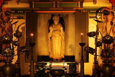 Lighting, Sculpture, Holy places, Interior design, Temple, Place of worship, Statue, Mythology, Lamp, Carving,