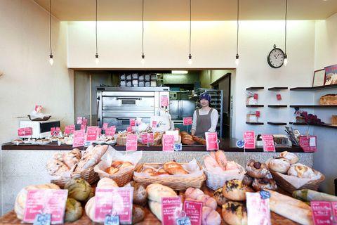 Food, Cuisine, Countertop, Bread, Kitchen, Shelf, Cupboard, Light fixture, Peach, Cabinetry,