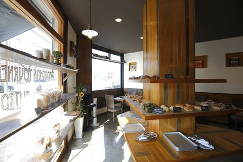 Lighting, Interior design, Room, Table, Furniture, Interior design, Ceiling, Dishware, Plate, Picture frame,