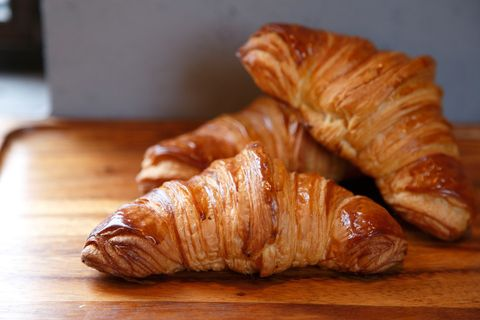 Wood, Food, Croissant, Cuisine, Hardwood, Baked goods, Dish, Wood stain, Plate, Snack,