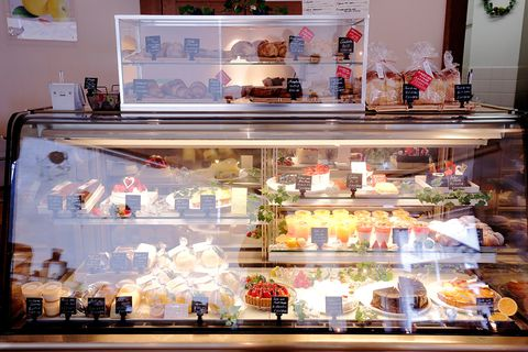 Food, Cuisine, Display case, Sweetness, Dessert, Retail, Picture frame, Display window, Bottle, Delicacy,