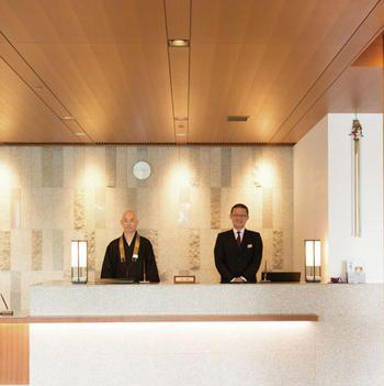 Lighting, Interior design, Coat, Ceiling, Suit, Light fixture, Interior design, Ceiling fixture, Material property, Electricity,