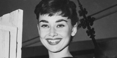 Hair, Photograph, Facial expression, Eyebrow, Hairstyle, Smile, Retro style, Black-and-white, Forehead, Monochrome photography,