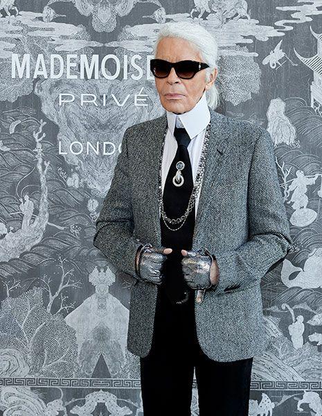 Eyewear, Vision care, Glasses, Collar, Dress shirt, Formal wear, Pattern, Sunglasses, Style, Coat,