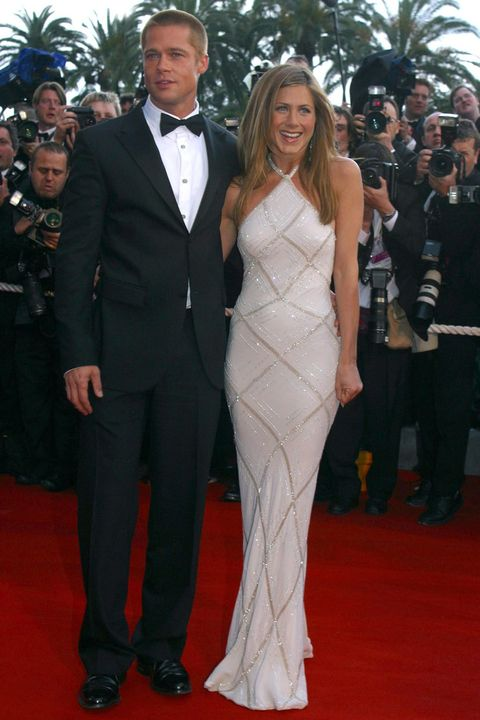 Red carpet, Carpet, Suit, Clothing, Dress, Formal wear, Gown, Event, Flooring, Tuxedo,