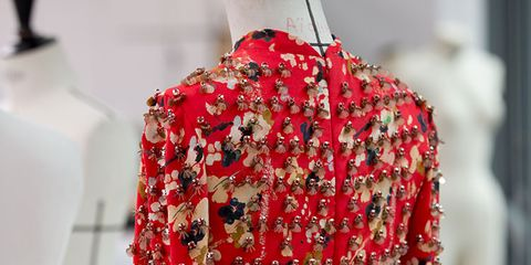 Sleeve, Textile, Red, Pattern, Mannequin, Carmine, Fashion, Maroon, One-piece garment, Design,