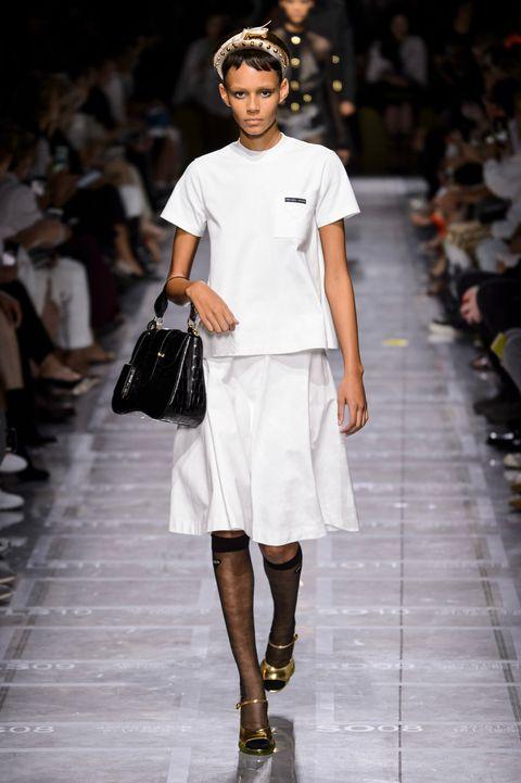 Fashion model, Fashion, Fashion show, Runway, White, Clothing, Shoulder, Fashion design, Public event, Human,