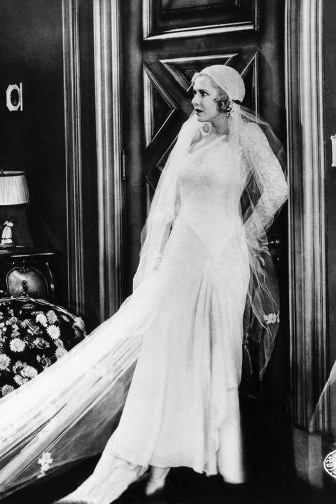 Wedding dress, Photograph, Gown, Dress, Bridal veil, Clothing, Bridal clothing, Bride, Bridal accessory, Shoulder,