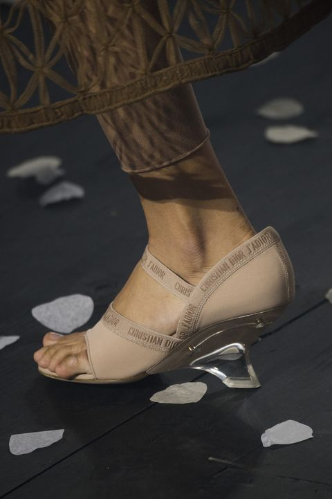 Human leg, Joint, Fashion, Beige, Tan, Foot, Ankle, Natural material, Silver, Leather,