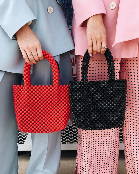 Red, Handbag, Pattern, Design, Street fashion, Bag, Hand, Fashion accessory, Polka dot, Pattern,