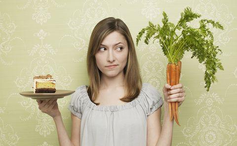 Carrot, Plant, Food, Brown hair, Vegetable, Vegetarian food, Long hair, Gesture, Leaf vegetable, Food craving,