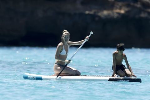Boating, Paddle, Recreation, Outdoor recreation, Rowing, Boat, Vehicle, Canoeing, Canoe, Water sport,