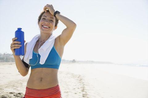 Water, Arm, Bikini, Vacation, Shoulder, Sports bra, Abdomen, Undergarment, Photography, Water bottle,