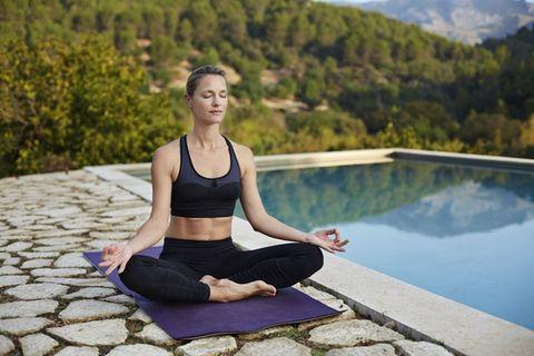 Physical fitness, Yoga, Yoga mat, Sitting, Sportswear, Shoulder, Beauty, Arm, Leg, Water,