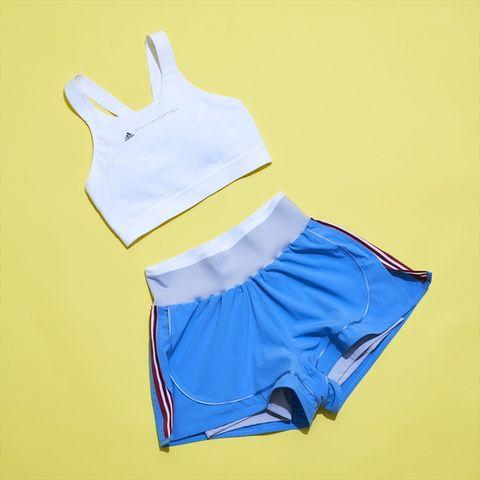 Clothing, Blue, Yellow, Sportswear, Sports uniform, Shorts, Crop top, Electric blue, Cycling shorts, Sleeve,