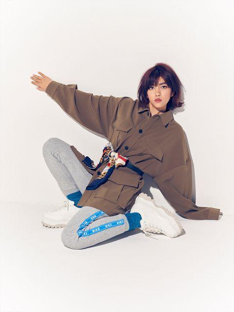 White, Sitting, Leg, Footwear, Joint, Knee, Outerwear, Shoe, Photography, Beige,