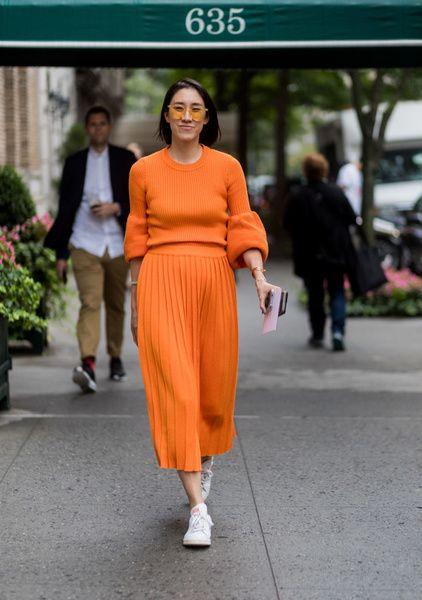 Orange, Street fashion, Fashion, Clothing, Fashion model, Shoulder, Waist, Footwear, Dress, Fashion show,