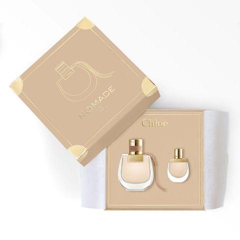 Perfume, Product, Skin, Beige, Fashion accessory, Cosmetics, Brass, Metal,