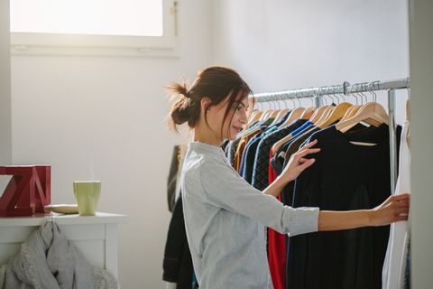 Shoulder, Clothes hanger, Room, Fashion design, Wall, Arm, Textile, Design, Joint, Outerwear,