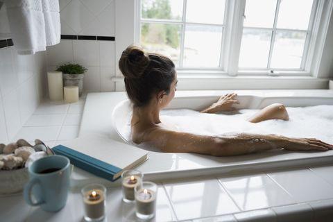 Bathing, Room, Bathtub, Hand, Bathroom, Interior design, Spa, Leisure, Plumbing fixture, Furniture,