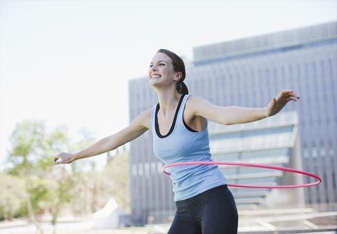 Shoulder, Toy, Arm, Hula hoop, Joint, Leg, Rhythmic gymnastics, Human body, Performing arts, Sportswear,