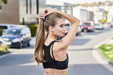 Hair, Shoulder, Clothing, Undergarment, Street fashion, Sports bra, Crop top, Hairstyle, Blond, Beauty,