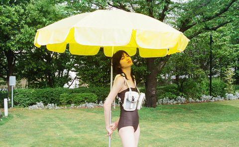 Umbrella, Yellow, Grass, Fashion accessory, Summer, Shade, Fun, Tree, Vacation, Photography,